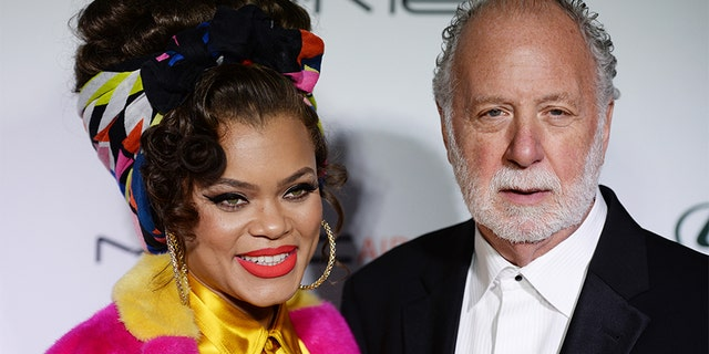 Singer Andra Day (L) and record producer Adrian Gurvitz arrive at the 3rd Annual Hollywood Beauty Awards at Avalon Hollywood on Feb. 19, 2017 in Los Angeles, Calif. — Getty