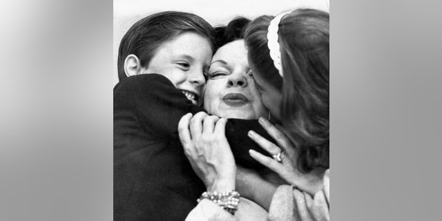 Judy Garland with two of her children, shortly after she settled in England.