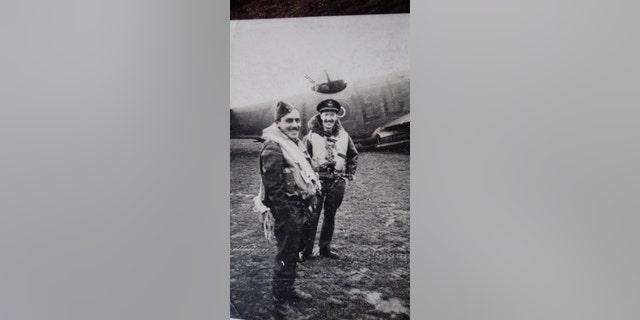 Phillips (left) and a fellow a fellow RAF officer with a Lockheed Martin Ventura aircraft in the background.(Hansons Auctioneers)