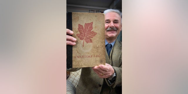 Adrian Stevenson, a militaria expert at Hansons Auctioneers, with the diary. (Hansons Auctioneers)