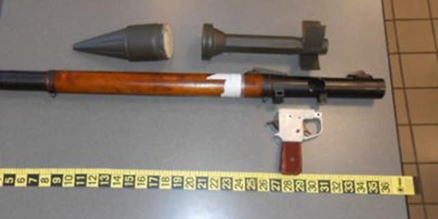 Officers quickly found that the grenade launcher was not a functioning weapon, but a replica.