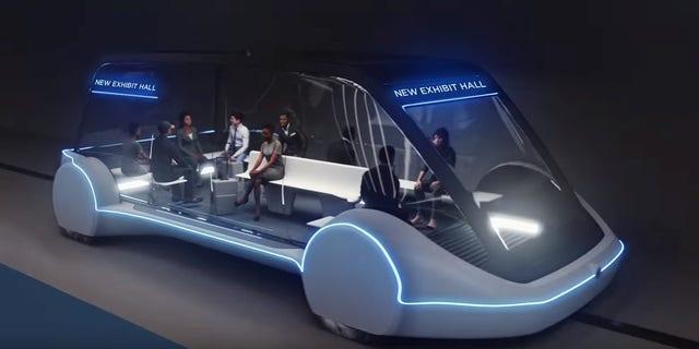 High-Occupancy Autonomous Electric Vehicle (AEV) running between Exhibit Halls.