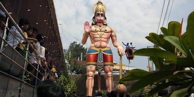 A statue of Hindu monkey-god Hanuman is washed during the birthday of Lord Hanuman in Hyderabad, India.