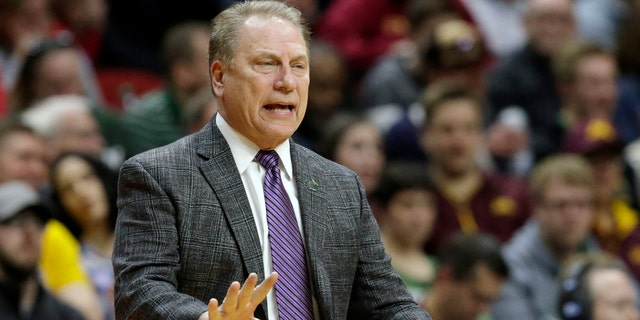 Michigan State coach Tom Izzo moves to his players during the first half of Thursday's game. (AP Photo / Nati Harnik)