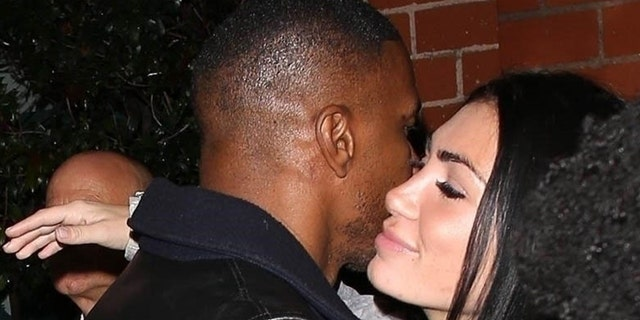 Jamie Foxx hugs a poser lady on Mar 6, 2019 in Beverly Hills, Calif.