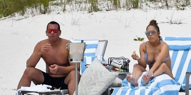 Jennifer Lopez and Alex Rodriguez on the beach