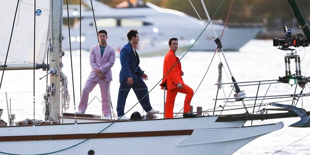 The Jonas Brothers were spotted in Miami on a sailboat filming what appears to be a video for an upcoming project after recently surprising fans with new music.
