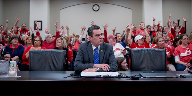 In a room packed with teachers last month, Kentucky State Representative Ken Upchurch spoke on a bill that would change how individuals are nominated to the Kentucky teachers retirement systems board of trustees. (AP Photo/Bryan Woolston, File)