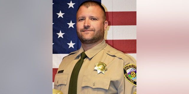Sheriff's Deputy Ryan Thompson, 42, was shot and killed and a police officer was wounded after they exchanged gunfire with a road rage driving suspect Tuesday, authorities said Wednesday. (Kittitas County Sheriff's Office via AP)
