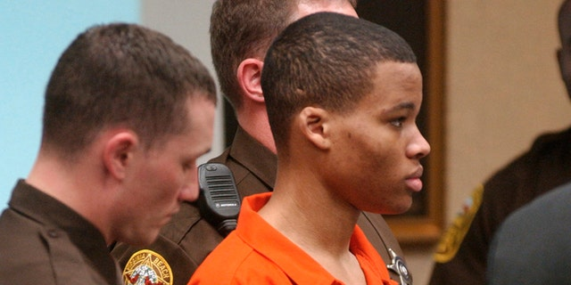 FILE - In this Oct. 20, 2003 record photo, Lee Boyd Malvo listens to justice record during a hearing of associate sniper think John Allen Muhammad in Virginia Beach, Va. (AP Photo/Martin Smith-Rodden, Pool, File)