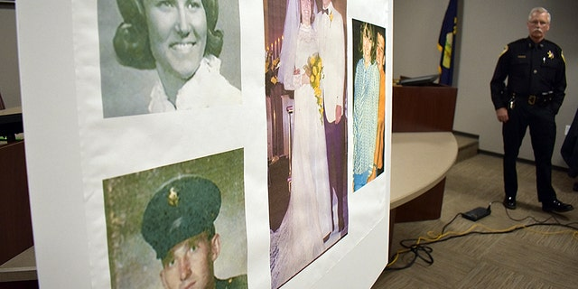 Photos of Linda and Clifford Bernhardt, who were killed in 1973, are displayed at a press conference at the Yellowstone County administrative offices in Billings, Montana on Monday, March 25, 2019. Yellowstone County Sheriff Mike Linder, pictured at right, says authorities have identified the couple's now-deceased killer.