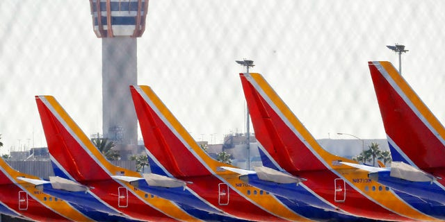 Boeing 737 Max jets are grounded at Sky Harbor International Airport, Thursday, March 14, 2019 in Phoenix.