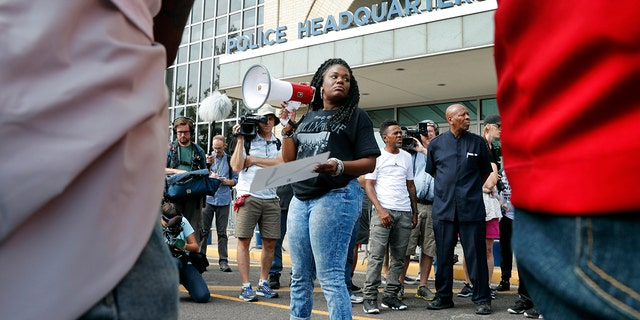 FILE - In this September 17, the 2017 file picture, Cori Bush speaks on a bullhorn to protesters outside St. Louis Police Department headquarters in St. Louis. (AP Photo / Jeff Roberson, File)