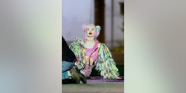 """Margot Robbie is seen filming an intense action scene for her latest film """"Birds of Prey (And the Fantabulous Emancipation of One Harley Quinn).'' Margot shot a scene in a truck where she jumps out and lets the truck crash to watch explosions."""