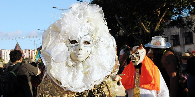 Revelers pose during the Carnival parade in the streets of Fort-de-France on the French Caribbean island of Martinique, on February 10, 2013. The Carnaval started on February 9, 2013 and will run until Ash Wednesday on February 13, 2013 when Vaval, a giant papier-mache figure symbolizing the king of the carnival, is burned. AFP PHOTO/ JEAN-MICHEL ANDRE (Photo credit should read JEAN-MICHEL ANDRE/AFP/Getty Images)