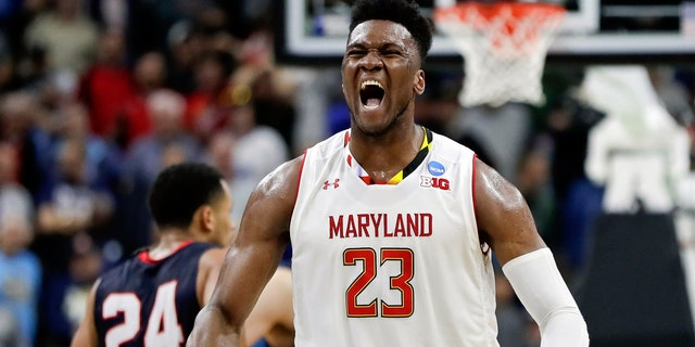 Maryland's Bruno Fernando celebrates in the last few moments of Thursday's fight against Belmont. (AP Photo / John Raoux)