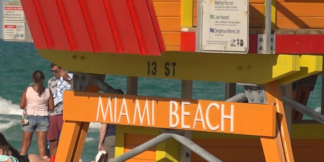 Miami Beach lifeguards watch over the beach scene