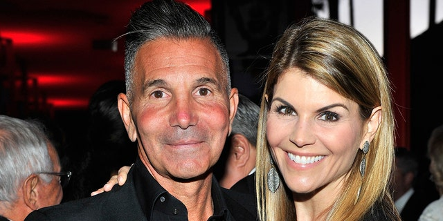 Designer Mossimo Giannulli and wife Lori Loughlin in April 2015.