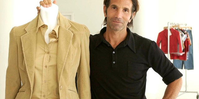 This May 15, 2002 file photo shows Los-Angeles based clothing designer Mossimo Giannulli posing with his fall preview clothing for Target department stores in New York. Giannulli and his wife, actress Lori Loughlin were charged along with nearly 50 other people Tuesday in a scheme in which wealthy parents bribed college coaches and other insiders to get their children into some of the most elite schools in the country, federal prosecutors said.