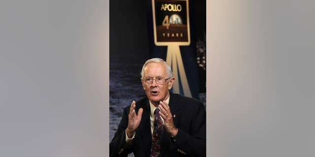 File photo - Apollo 16 astronaut Charles Duke responds to a question during a live television interview on Monday, July 20, 2009, at NASA Headquarters in Washington.