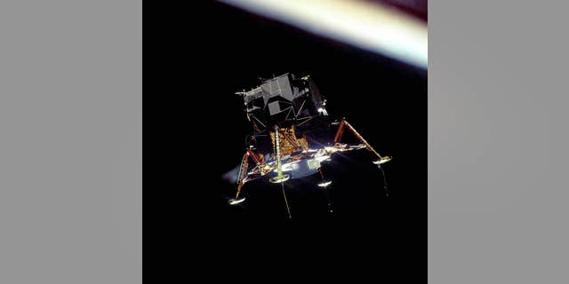 The Apollo 11 Lunar Module Eagle, in a landing configuration, photographed in lunar orbit from the Command and Service Module Columbia.