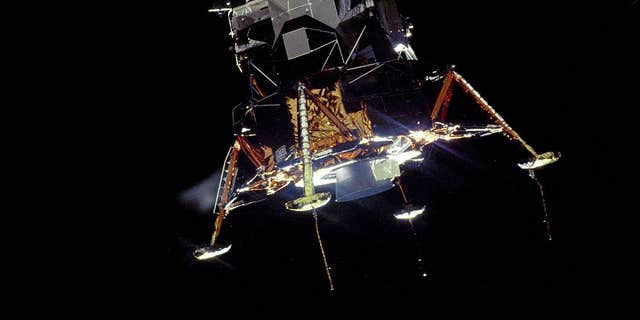 The Apollo 11 Lunar Module Eagle, in a alighting configuration, photographed in lunar circuit from a Command and Service Module Columbia.