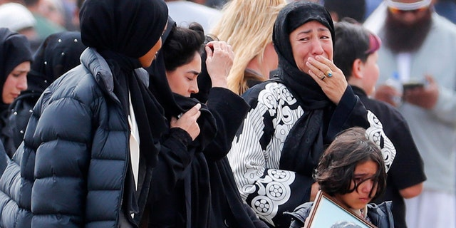 Mourners arrive for a burial service of a victim from the March 15 mosque shootings at the Memorial Park Cemetery in Christchurch, New Zealand on Thursday. (AP Photo/Vincent Thian)