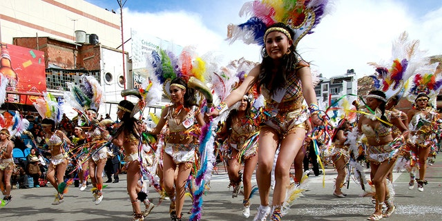 """ORURO, BOLIVIA - FEBRUARY 25: Tobas' dancers perform as part of Oruro Carnival 2017 on February 25, 2017 in Oruro, Bolivia. Oruro Carnival is one of Bolivia's most important cultural traditions and has been proclamed as one of UNESCO's """"Masterpieces of the Oral and Intangible Heritage of Humanity"""". (Photo by Jose Luis Quintana/LatinContent/Getty Images)"""