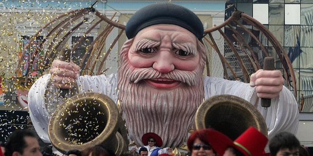 Patras, GREECE: Participants of the most famous Greek carnival in the city of Patras, parade in the streets to mark the last day of the carnival 05 March 2006. Thousands of visitors arrived to take part in the celebrations in the city of Patras, which is the European Capital of Culture for the year 2006. AFP PHOTO/Louisa Gouliamaki (Photo credit should read LOUISA GOULIAMAKI/AFP/Getty Images)