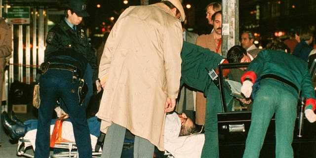 FILE - Mafia crime boss Paul Castellano lies on a stretcher outside Manhattan's Sparks Steak House in December 1985 after he and his bodyguards were shot and killed by John Gotti, who is then he became chief. (Associated Press)