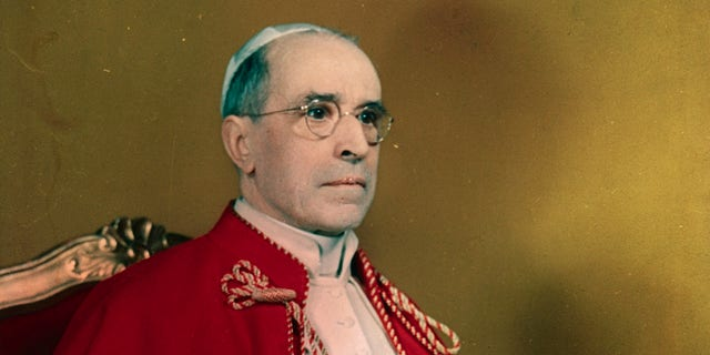 Portrait of Pope Pius XII seated on throne.