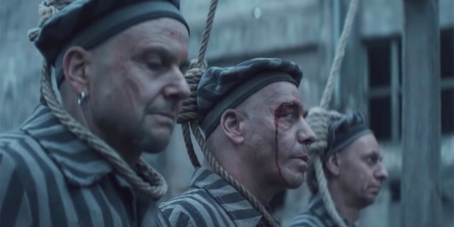 """German hard rock band Rammstein sparked criticism after posting a video promoting the group's new single """"Deutschland"""" that features band members dressed as concentration camp inmates standing on a gallows."""