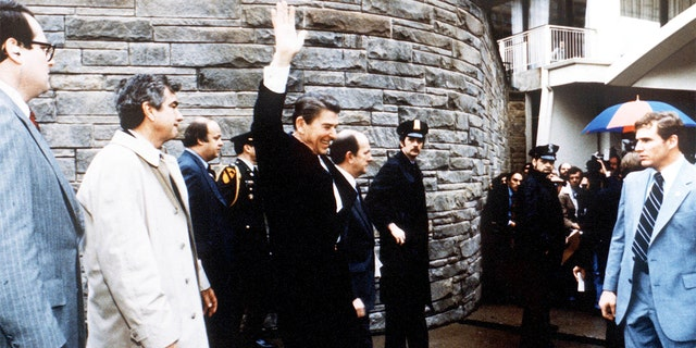 President Reagan waves to onlookers moments before an assassination attempt by John Hinckley Jr. in Washington in 1981.