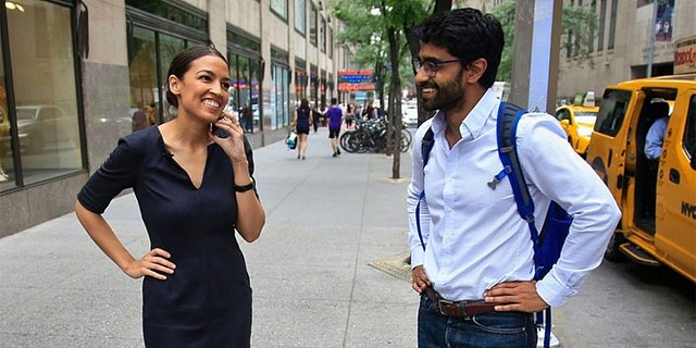 Alexandria Ocasio-Cortez and Saikat Chakrabarti are seen in this July 2018 photo. (AP Photo/Bebeto Matthews)