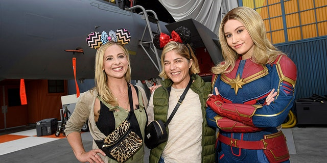 Sarah Michelle Gellar (left) and Selma Blair (center) went to Disneyland in California on Thursday. (Disneyland Resort)