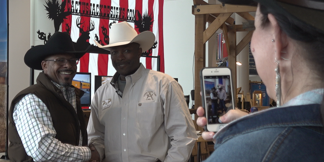"""Fred Whitfield (left)has won the Professional Rodeo Cowboys Association World Championships eight times. He has been considered a """"trailblazer"""" for African-Americans wanting to join the sport."""