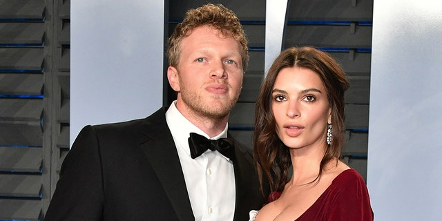 Emily Ratajkowski and husband Sebastian Bear-McClard say they have no plans of learning the gender of their child until age 18.