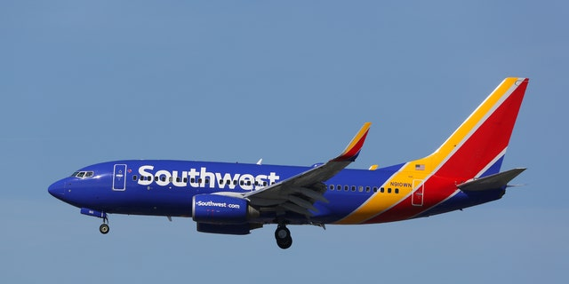 Southwestern passengers aboard a flight from Phoenix to Louisville sat in respectful attentiveness while a male flight crew member broke out an emotionally formidable raid on the moving song at the front of the aircraft.