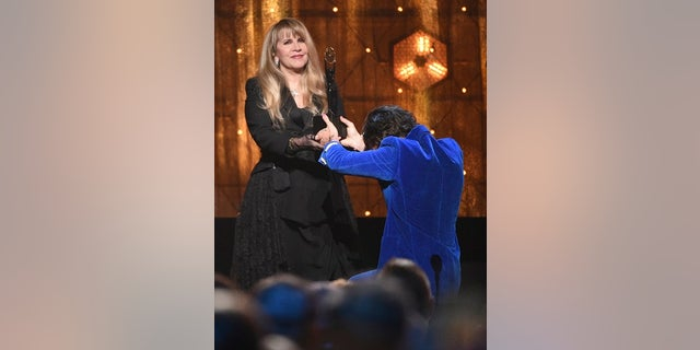 Harry Styles, right, presents an award to Stevie Nicks at the Rock & Roll Hall of Fame ceremony at the Barclays Center on Friday, March 29, 2019, in New York.