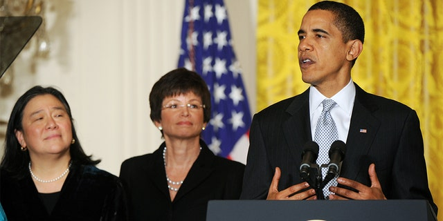 Tina Tchen, left, with then-President Obama and Valerie Jarrett at the White House in 2009.