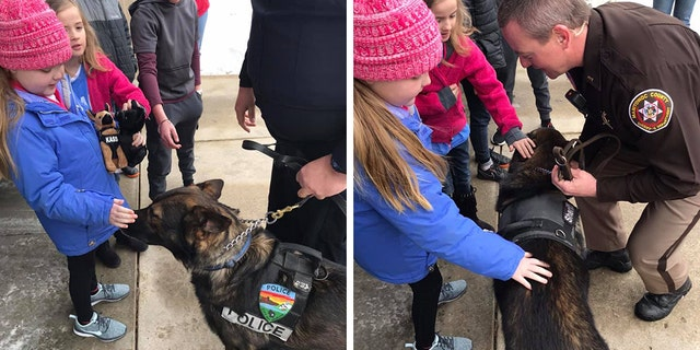 Emma Mertens loves dogs. So close to 40 police department and their K-9 officers visited on her on Saturday.