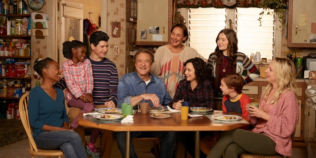 "ABC's ""The Conners"" stars Maya Lynne Robinson as Geena Williams-Conner, Jayden Rey as Mary, Michael Fishman as D.J. Conner, John Goodman as Dan Conner, Laurie Metcalf as Jackie Harris, Sara Gilbert as Darlene Conner, Emma Kenney as Harris Conner, Ames McNamara as Mark, and Lecy Goranson as Becky Conner."