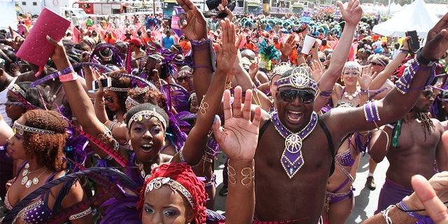 PORT OF SPAIN, TRINIDAD - FEBRUARY 17: Masqueraders from the band Fantasy Carnival perform in the Queen's Park Savannah during the Parade of Bands as part of Trinidad and Tobago Carnival on February 17, 2015 in Port of Spain, Trinidad. (Photo by Sean Drakes/LatinContent/Getty Images)