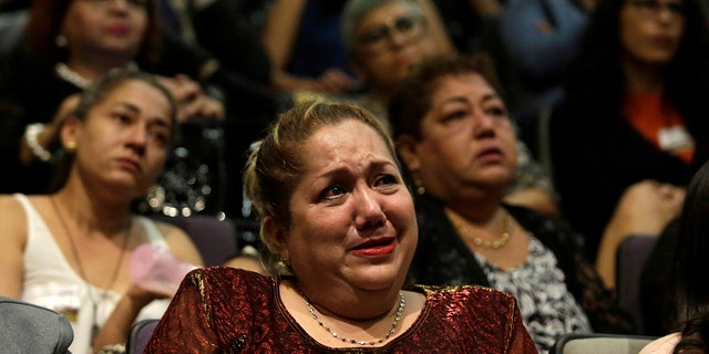 A relative of five youths killed in 2016 after police kidnapped them and then turned them over to members of a drug gang, reacts during a public apology by the Veracruz state government, in Mexico City, Mexico March 4, 2019.