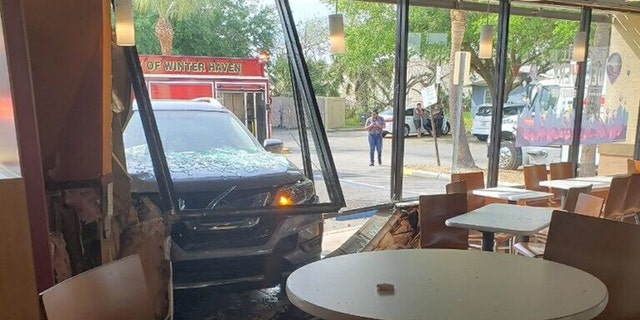 The customer had gotten up seconds before the SUV crashed into his table.