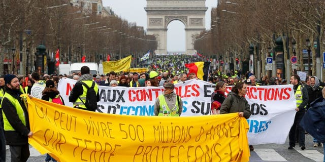 Yellow Vest protesters gather at the Arc de Triomphe in Paris, Saturday, March 9, 2019. French Yellow Vests protested for a 17th straight weekend in Paris and other cities against the government's economic policies they see as favoring the rich.