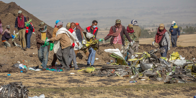 Rescuers work at the scene of an Ethiopian Airlines flight crash near Bishoftu, or Debre Zeit, south of Addis Ababa, Ethiopia, last Monday.