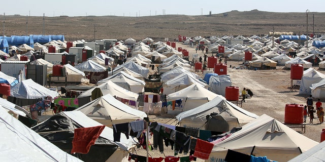 A picture taken in February 2017 shows a general view of the tents housing displaced Iraqi refugees who have recently fled from Mosul in a camp in al-Hawl, located in northeastern Syria.