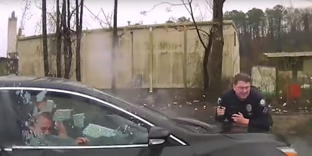 The moment that Little Rock OfficerSimpson crashes intoBradley Blackshire's vehicle as OfficerCharles Stark is firing at the vehicle.