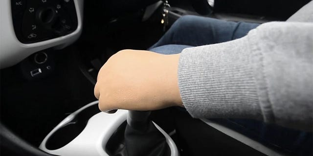 One-armed driving instructor teaches stick-shift skills